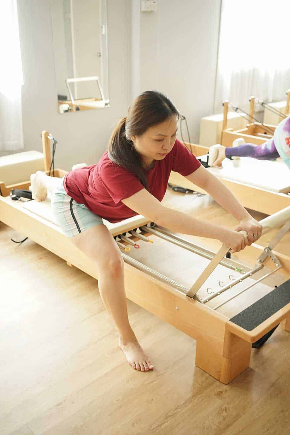 A Client works on their knee pain by doing Clinical Pilates moves that help strengthen the joint.